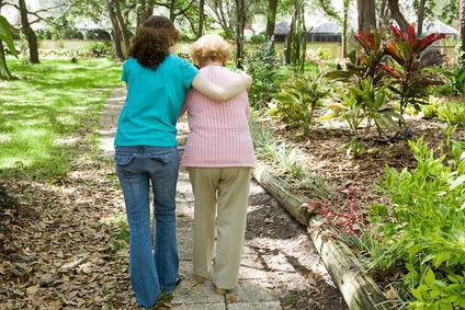 Daughter walking with elderly mother